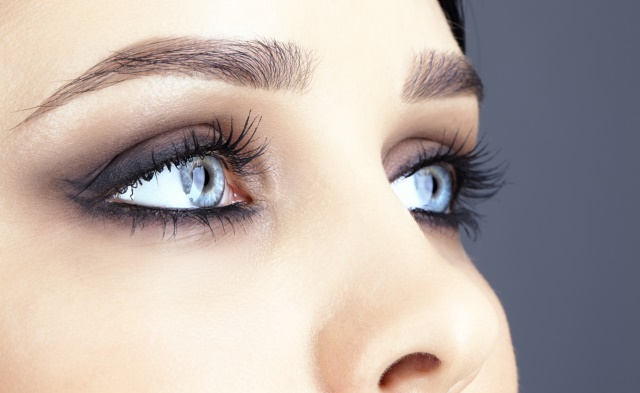 Closeup shot of woman eye with evening makeup